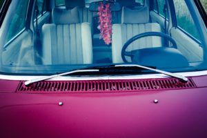 pink care with wind shield wipers