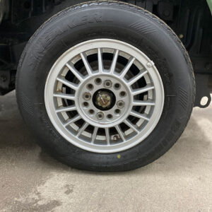 Clean tire on wet cement